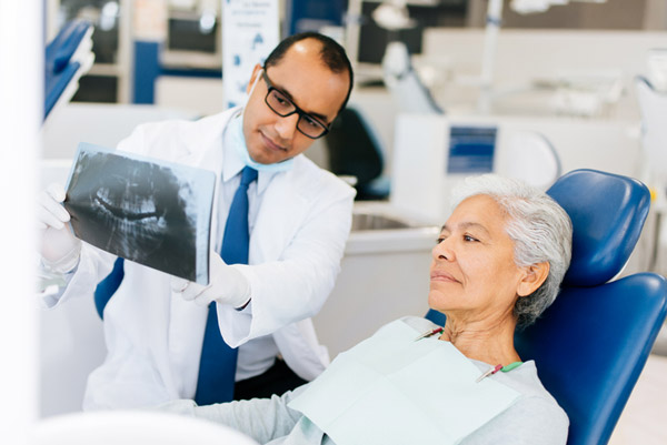 Dental patient looking at an x-ray for dental implants at Malmquist Oral and Maxillofacial Surgery in Portland, OR
